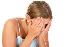 Woman washing face Stock Image