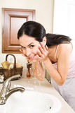 Woman washing face Royalty Free Stock Images