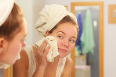 Woman washing face in bathroom. Hygiene. Woman cleaning washing her face with clean water in bathroom. Girl taking care of her complexion. Morning hygiene Royalty Free Stock Photography