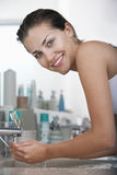 Woman Washing Face At Bathroom Sink Royalty Free Stock Photo