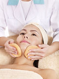 Woman washing  face by sponge. Royalty Free Stock Photography