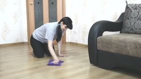 Woman washing the floor with a cloth stock video