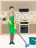 Woman washing floor with mop Royalty Free Stock Photos