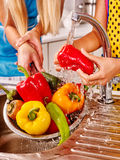 Woman washing fruit at kitchen Stock Photography