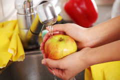 Woman washing fruits Royalty Free Stock Photography