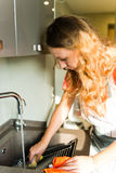 Woman Washing  grate. Kitchen. Royalty Free Stock Photos