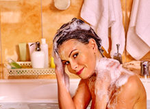 Woman washing hair in bubble bath Stock Photos