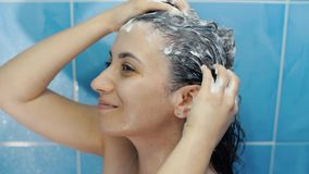 Woman washing hair. With shampoo stock video footage