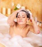 Woman washing hair by shampoo . Royalty Free Stock Image