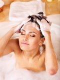 Woman washing hair by shampoo . Stock Photography