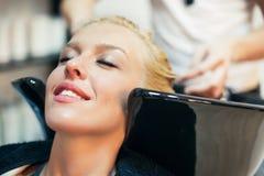 Woman Washing Hair Stock Photos