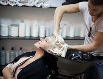 Woman Washing Hair Stock Images