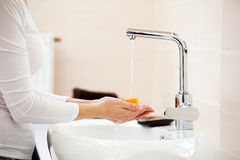 Woman washing hands Stock Photography