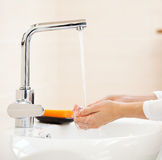 Woman washing hands Stock Image