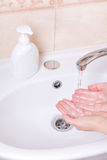 Woman washing hands close up Stock Image
