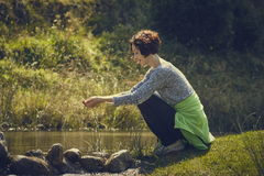 Woman washing hands in mountain stream water Stock Photo