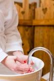 Woman washing hands at spa Stock Photos