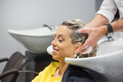 Woman washing head in hair salon Royalty Free Stock Photos
