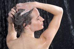 Woman washing head with shampoo Stock Photos
