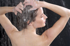 Woman washing head with shampoo Royalty Free Stock Photo