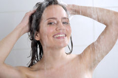 Woman washing head with shampoo Stock Photo
