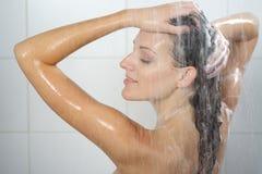 Woman washing head Stock Photo