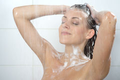 Woman washing head Stock Images