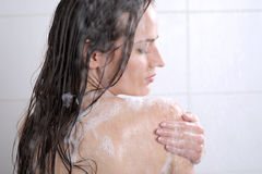 Woman washing her body shower gel Stock Images