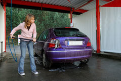 Woman washing her car Stock Photography