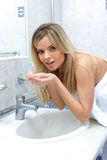 Woman washing her face Stock Photography