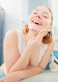 Woman washing her face with clean water in bathroom Stock Photos