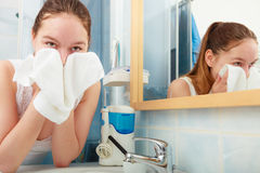 Woman washing her face with clean water in bathroom Royalty Free Stock Photos