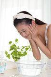 Woman washing her face Stock Images