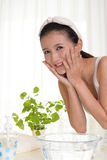 Woman washing her face Royalty Free Stock Photo