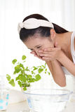 Woman washing her face Royalty Free Stock Photography
