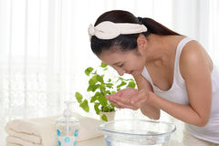 Woman washing her face Stock Image