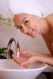 Woman washing her face Royalty Free Stock Photos