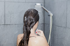 Woman washing her hair Royalty Free Stock Images