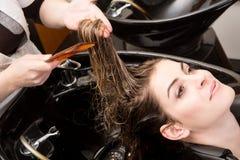 Woman washing her hair in hairsalon Stock Image