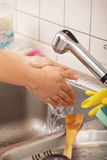 Woman washing her hands Stock Images