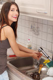 Woman washing her hands Stock Photography