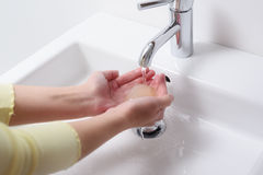 Woman washing her hands with soap Stock Images