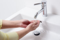 Woman washing her hands with soap Stock Photography