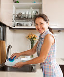 Woman washing kitchenware Royalty Free Stock Photography