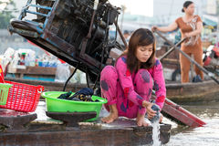 Woman washing laundry on boat Royalty Free Stock Photo
