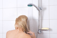 Woman washing long hair in shower Royalty Free Stock Photography