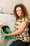 Woman with washing machine Royalty Free Stock Photography