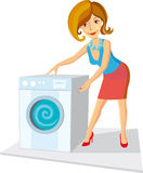 Woman_with_a_washing_machine Stock Photo