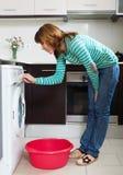 Woman with washing machine Royalty Free Stock Photo