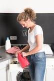 Woman at washing machine Stock Photography